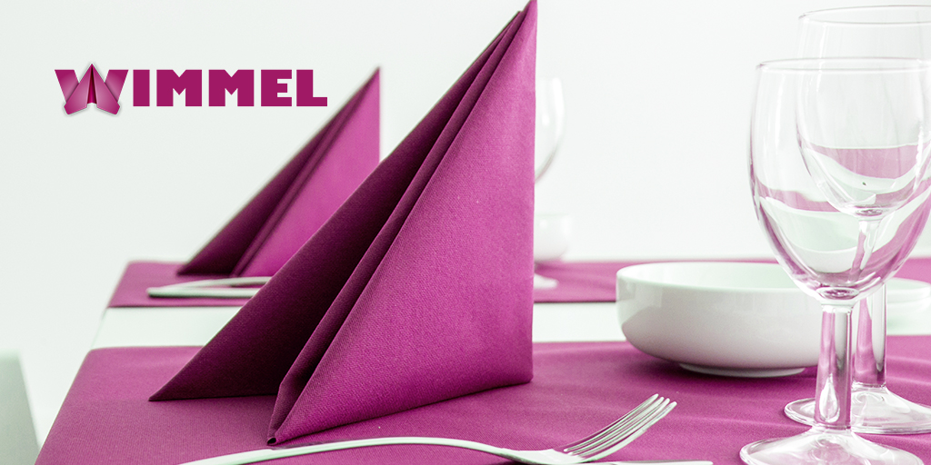 Violet paper napkins as table decoration
